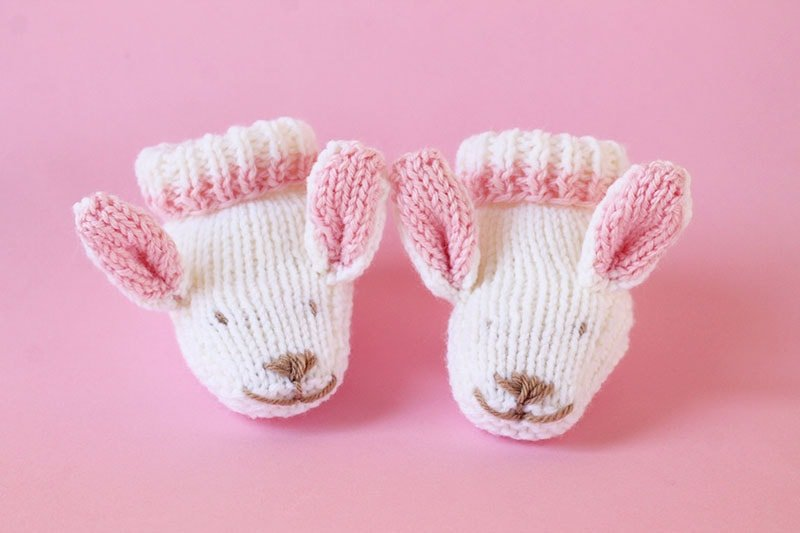 bunny baby slippers knit in white and pink yarn