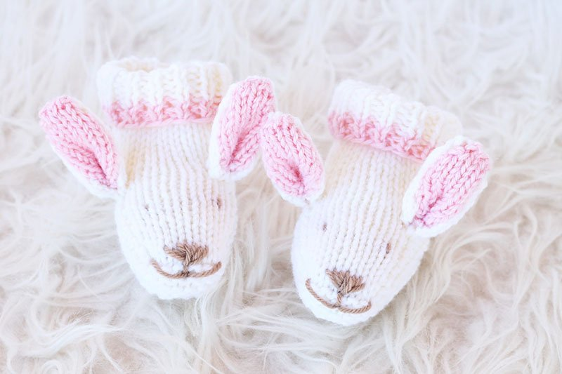 knitted bunny booties with a roll top cuff and ears