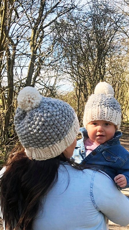 mom and baby wearing matching beanies