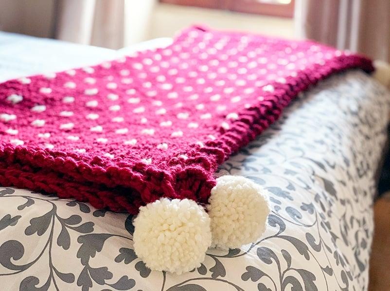 Christmas blanket with pom poms