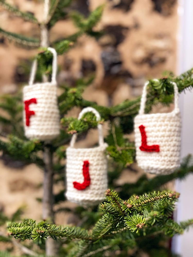 Crochet treat bags hanging on a Christmas tree
