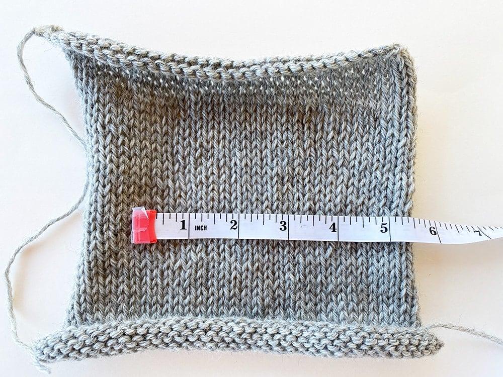 measuring a gauge swatch in knitting