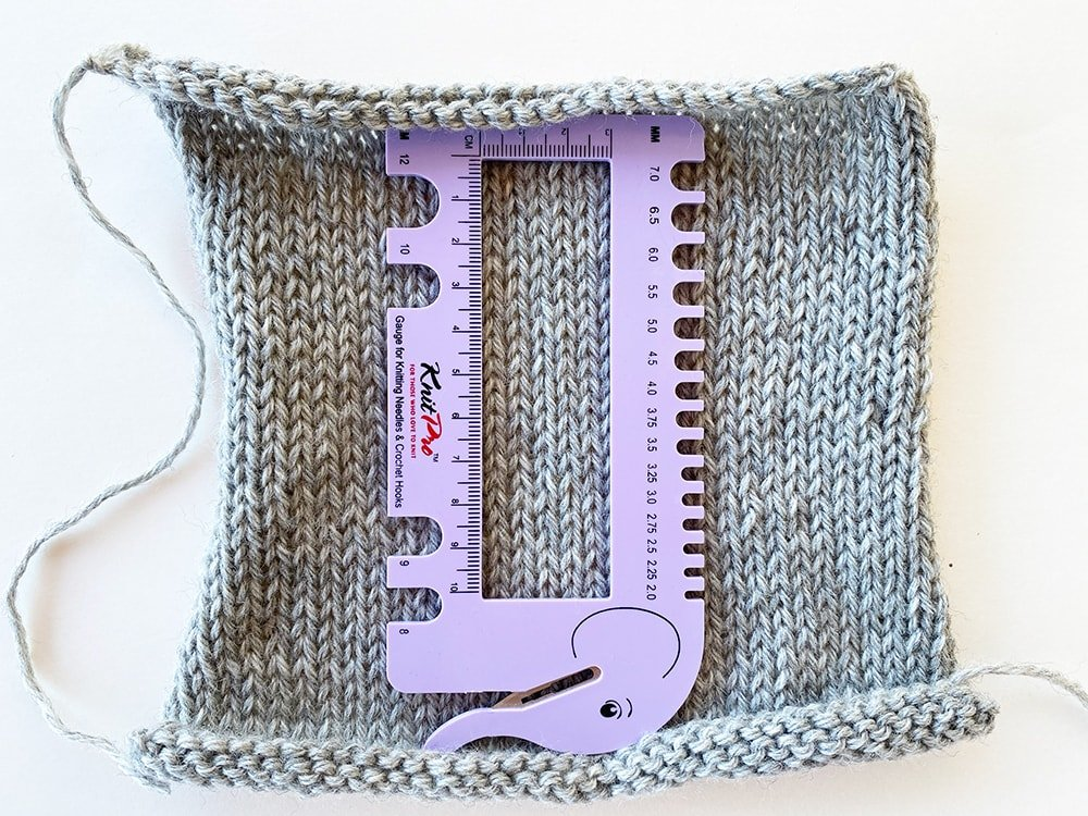 knit pro gauge measuring tool on a knitting square