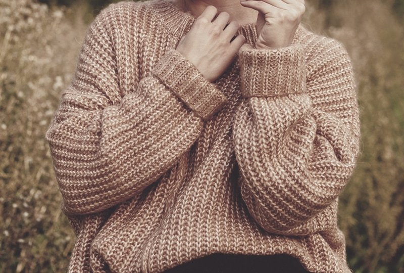 Girl wearing a reader favourites oversized knitted sweater