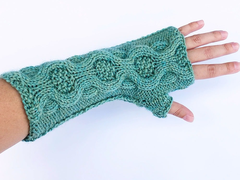 fingerless mitts featuring medallion moss cable