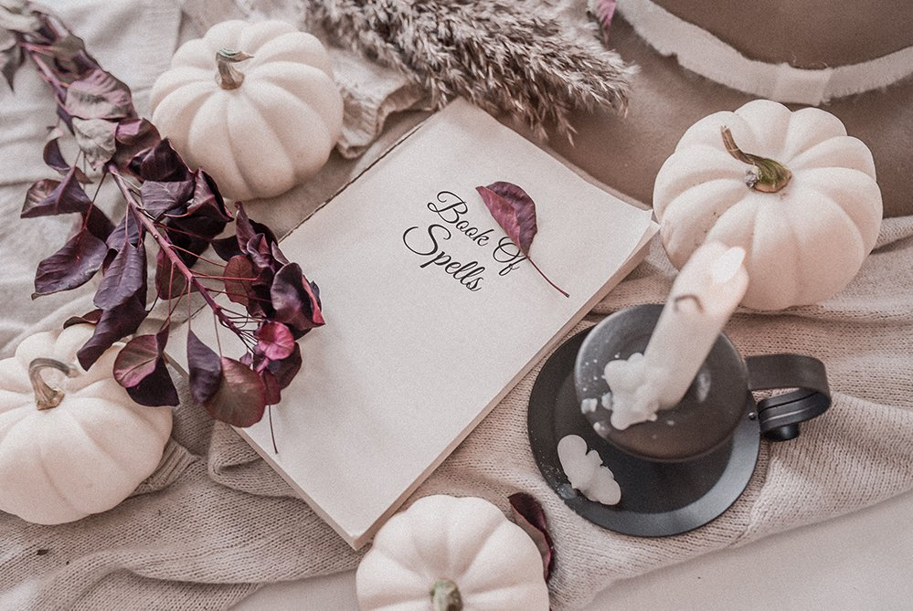 Spooky knits for Halloween flatlay with book of spells