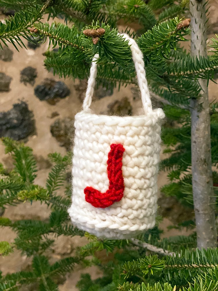 crochet bag on christmas tree with a crochet letter