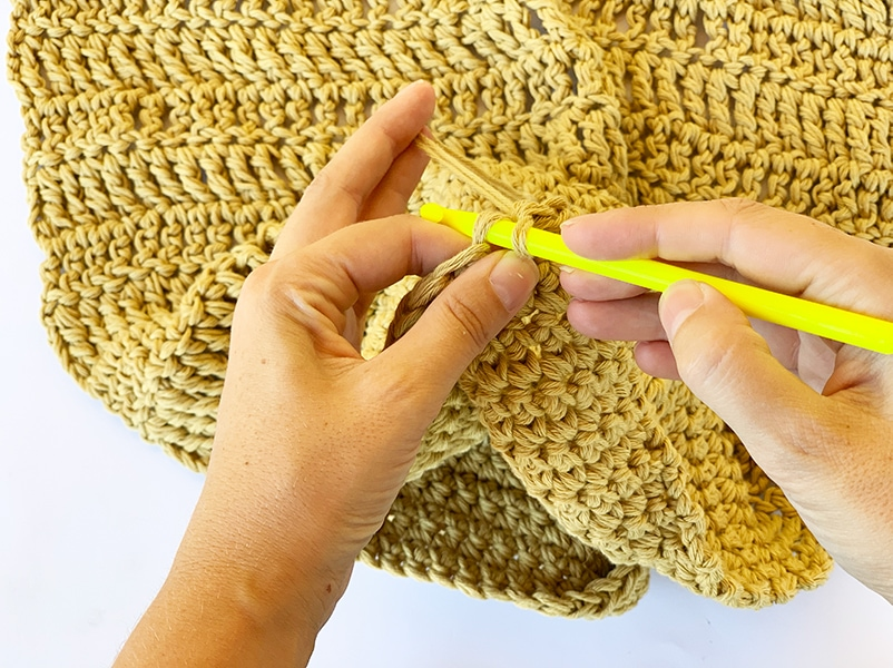 holding the crochet hook like a pencil in the right hand