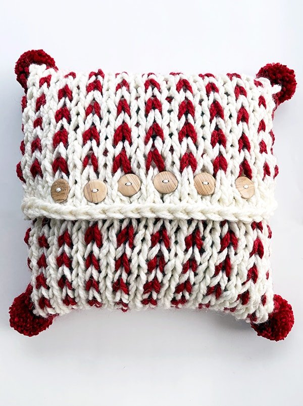 Pom poms added to the pillow cover