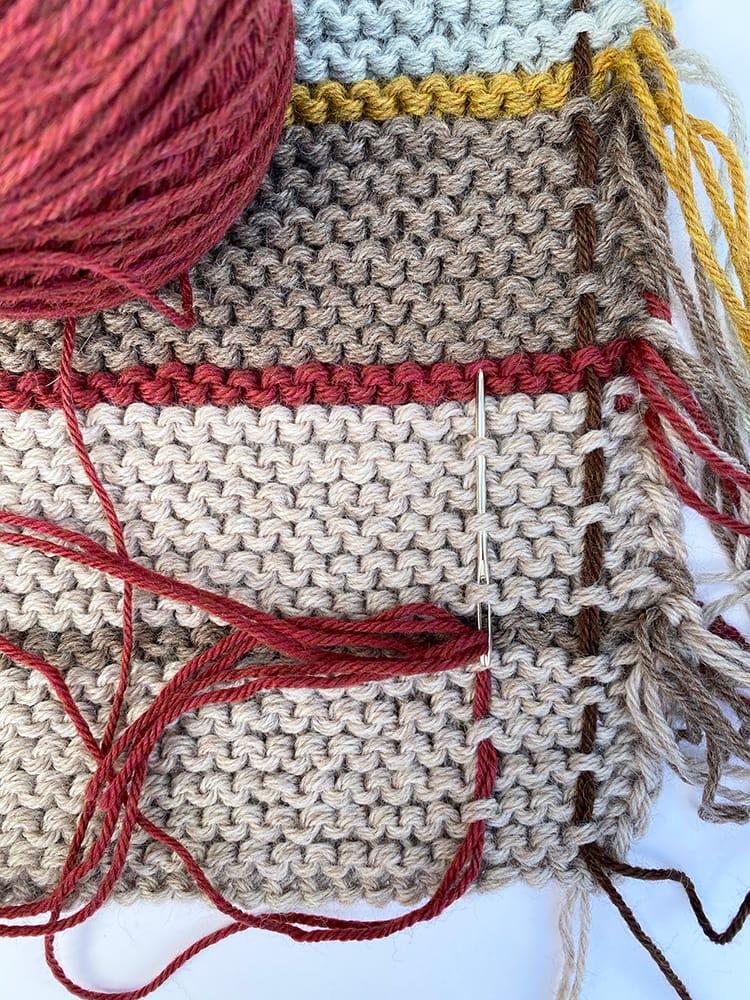 weaving tartan into the shawl