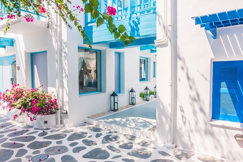 Santorini house painted white with tuquoise blue windows and shutters