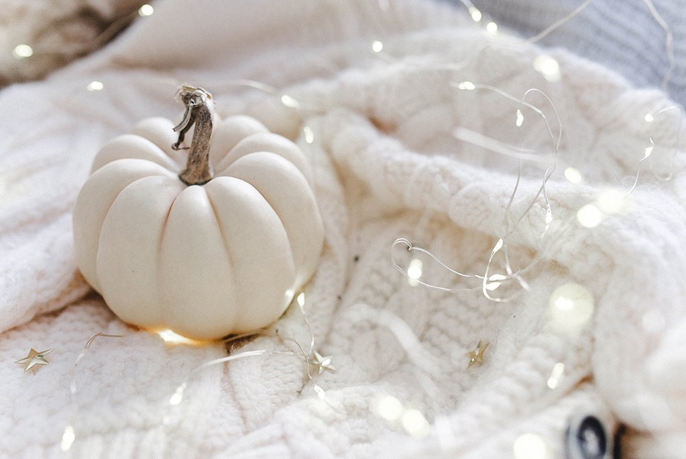 Spooky knits for Halloween white pumpkin and knitted blanket
