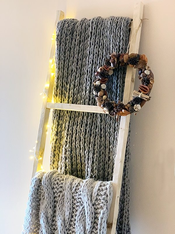 blanket ladder with hand knit blankets