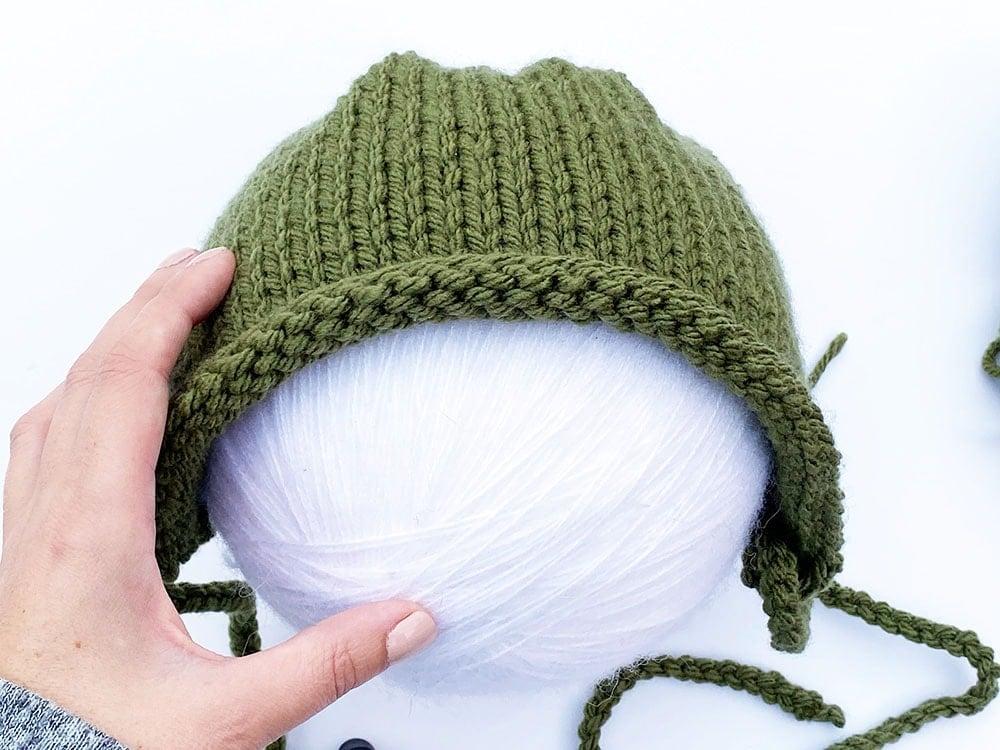 baby yoda hat on yarn ball