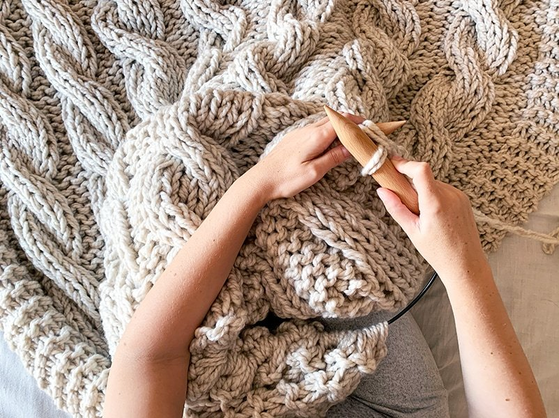 chunky cable knit blanket on large circular needles