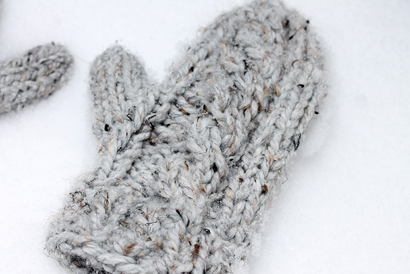 cable mittens in the snow