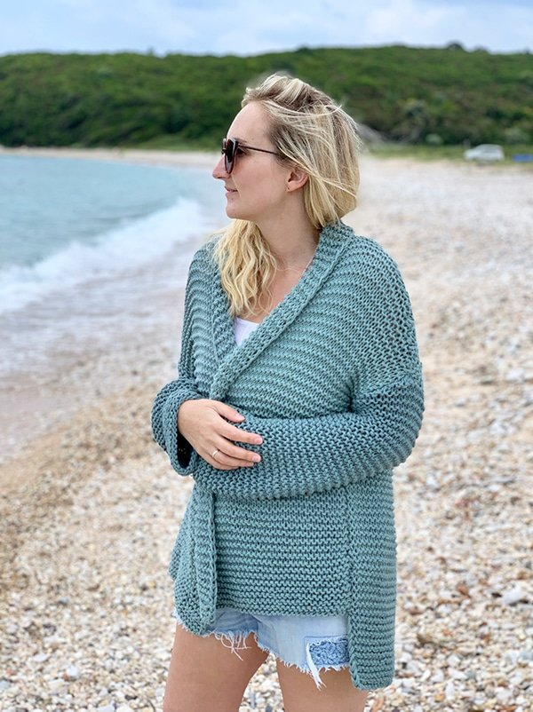 woman wearing a loose fitting knitted cardigan