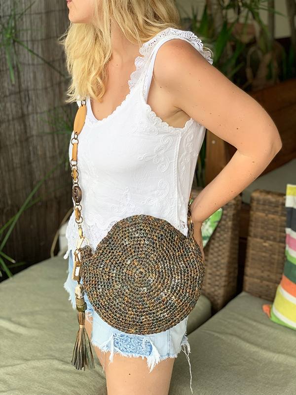 woman wearing a crochet circle bag