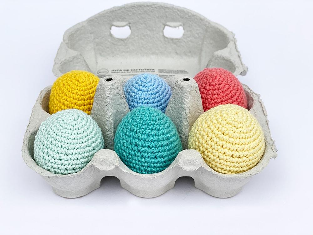 crochet Easter eggs in egg box