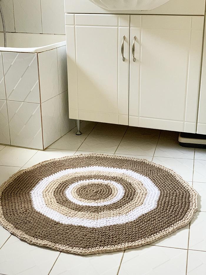 crochet bathroom rug lying on a bathroom floor