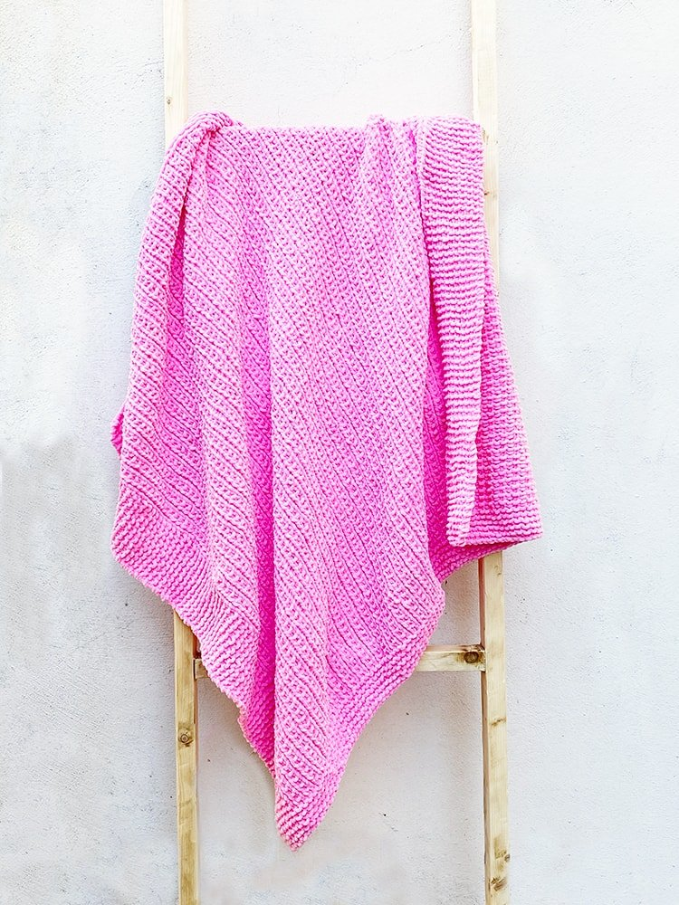 Large baby blanket knit with pink yarn
