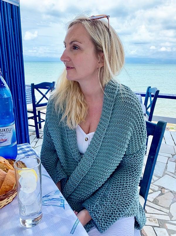 woman wearing a hand knit cardigan