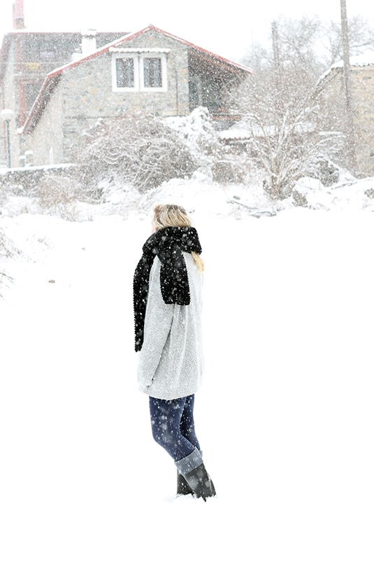woman wearing a black knitted scarf in the snow