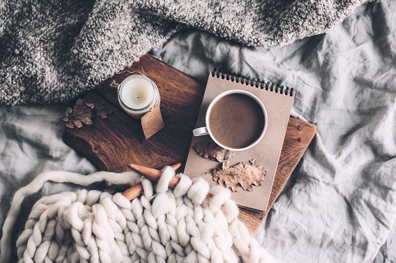 knitting on circular needles, hot chocolate and a notebook holiday favourites flatlay