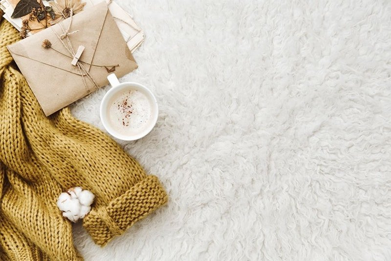 knitted sweater and coffee cup flatlay