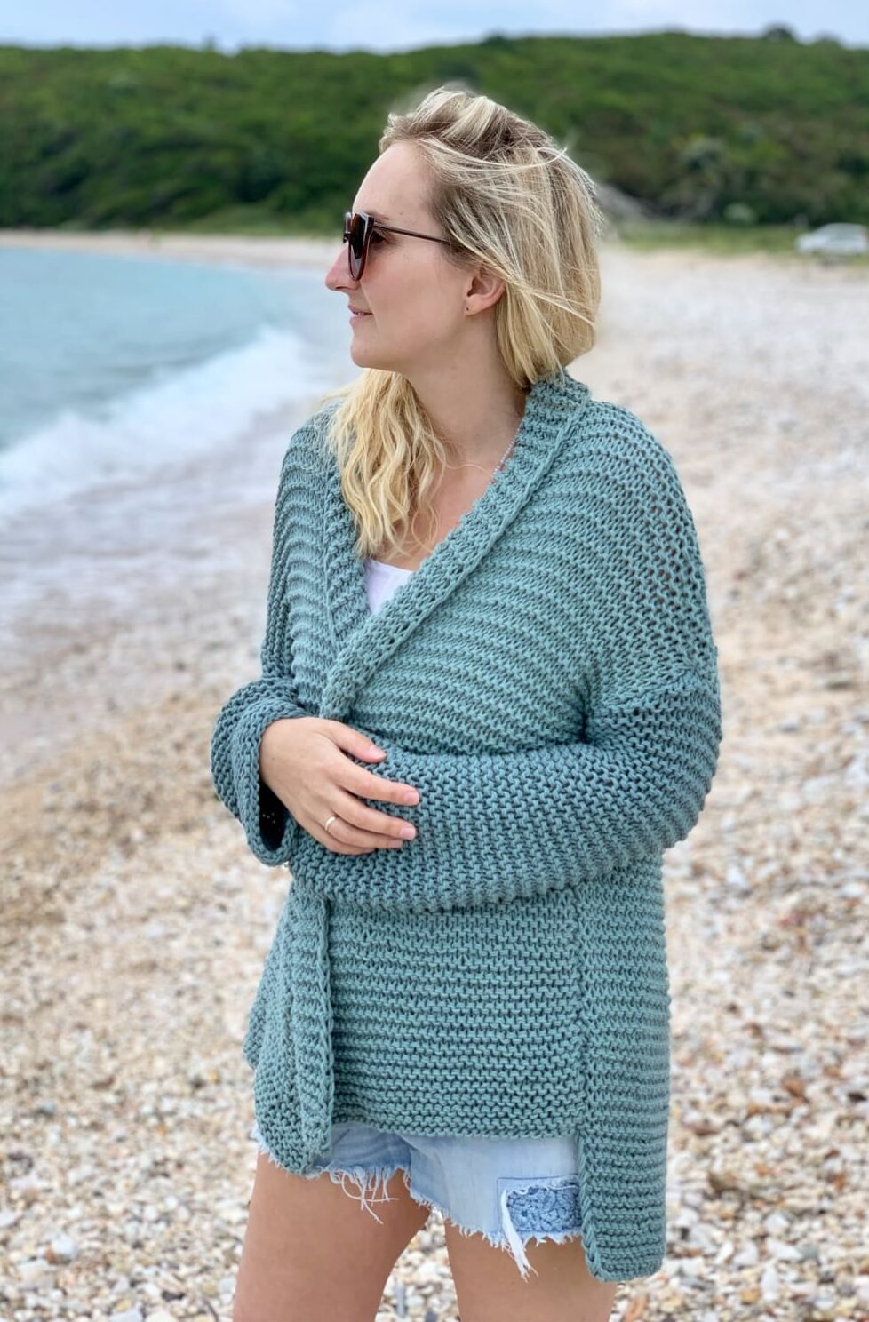 woman wearing a chunky knit cardigan