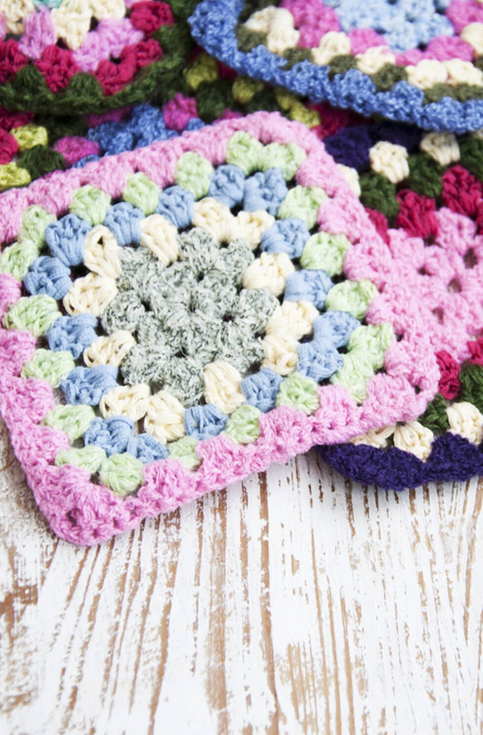 crochet squares made from colorful yarns