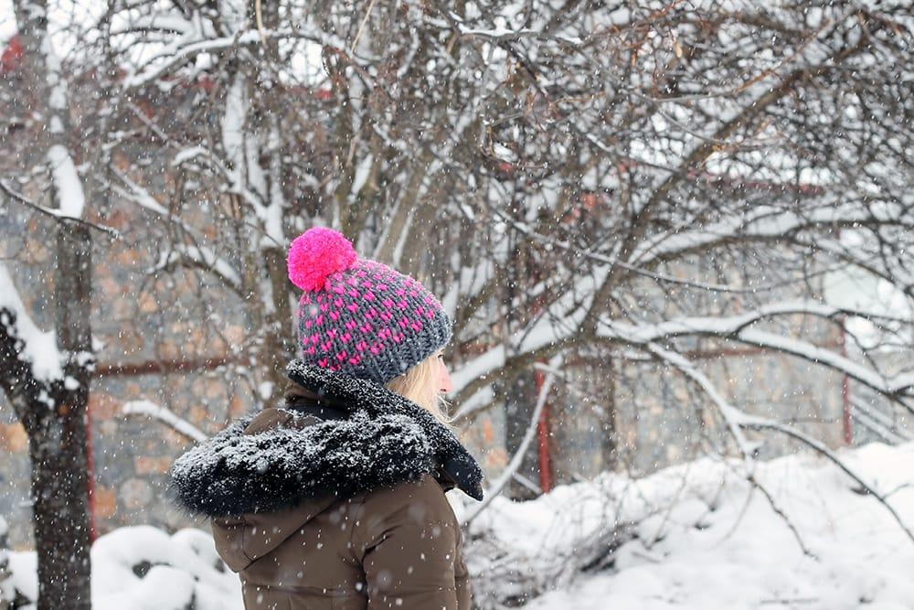 beanie hat with neon pink pom pom