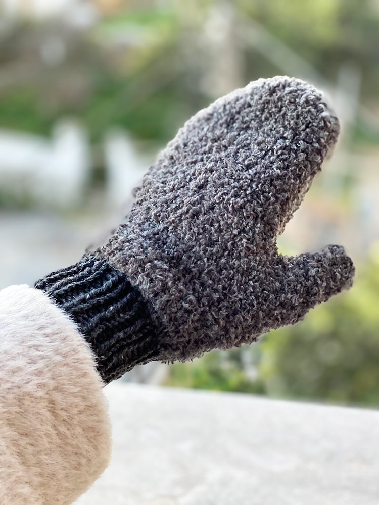 knitted mittens in textured grey yarn