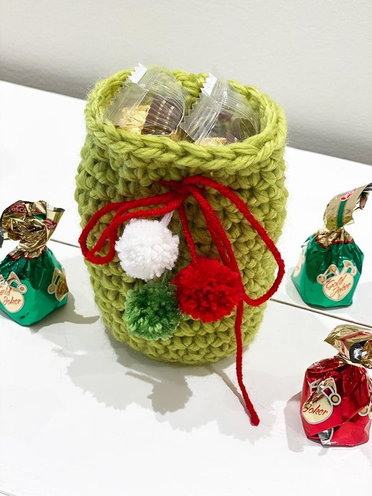 crochet drawstring bag in green yarn