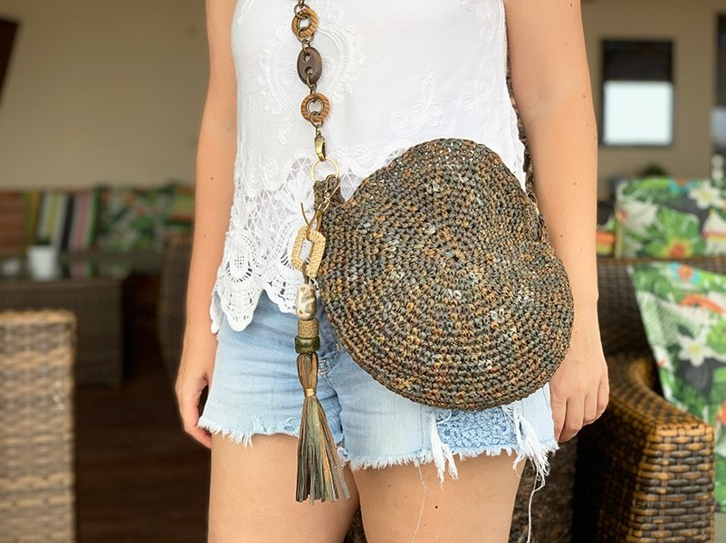 crochet circle bag with tassel and chain strap