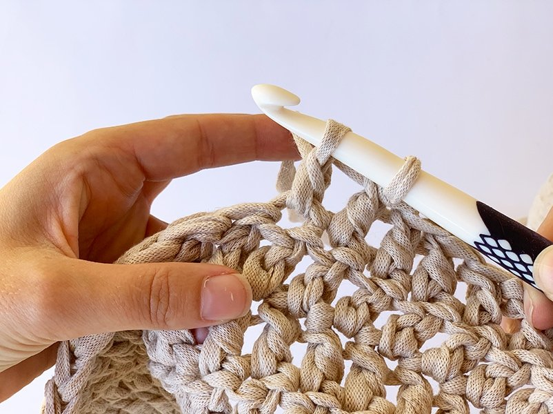 wrapping the yarn and pulling through two loops