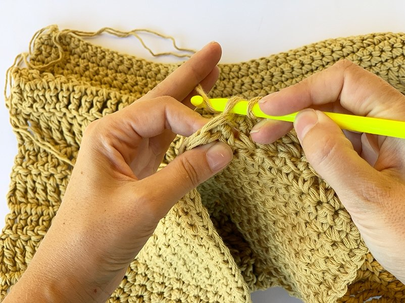 holding the crochet hook while working