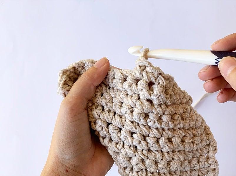 single crochet stitch shown on a prym crochet hook
