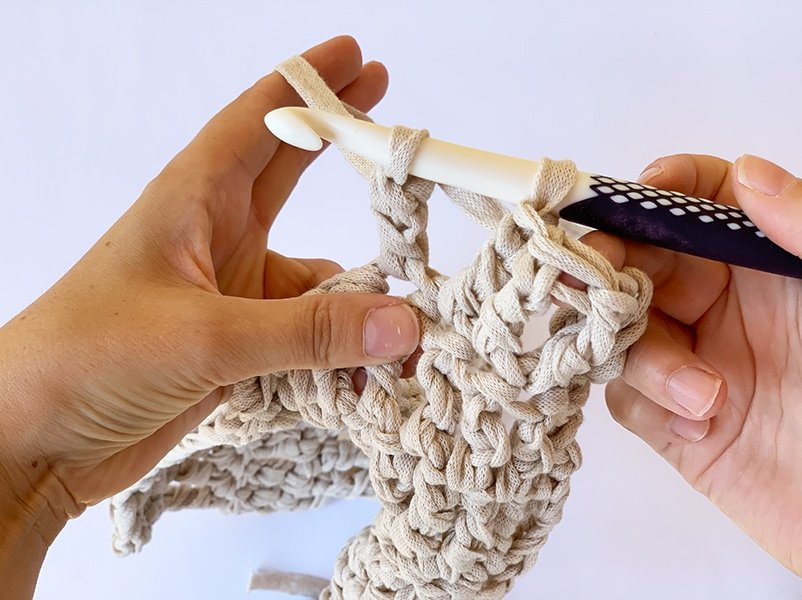 pull the yarn through the two loops on the hook for a triple crochet stitch
