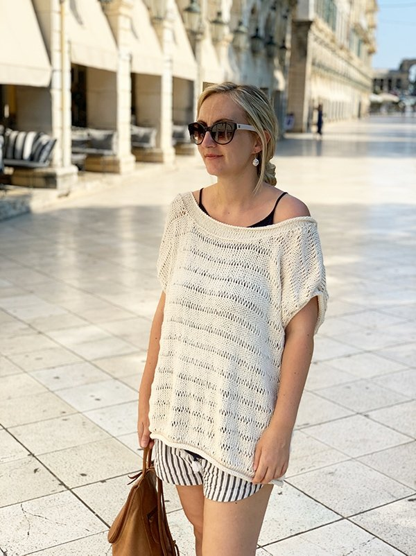woman wearing a drop stitch knit top