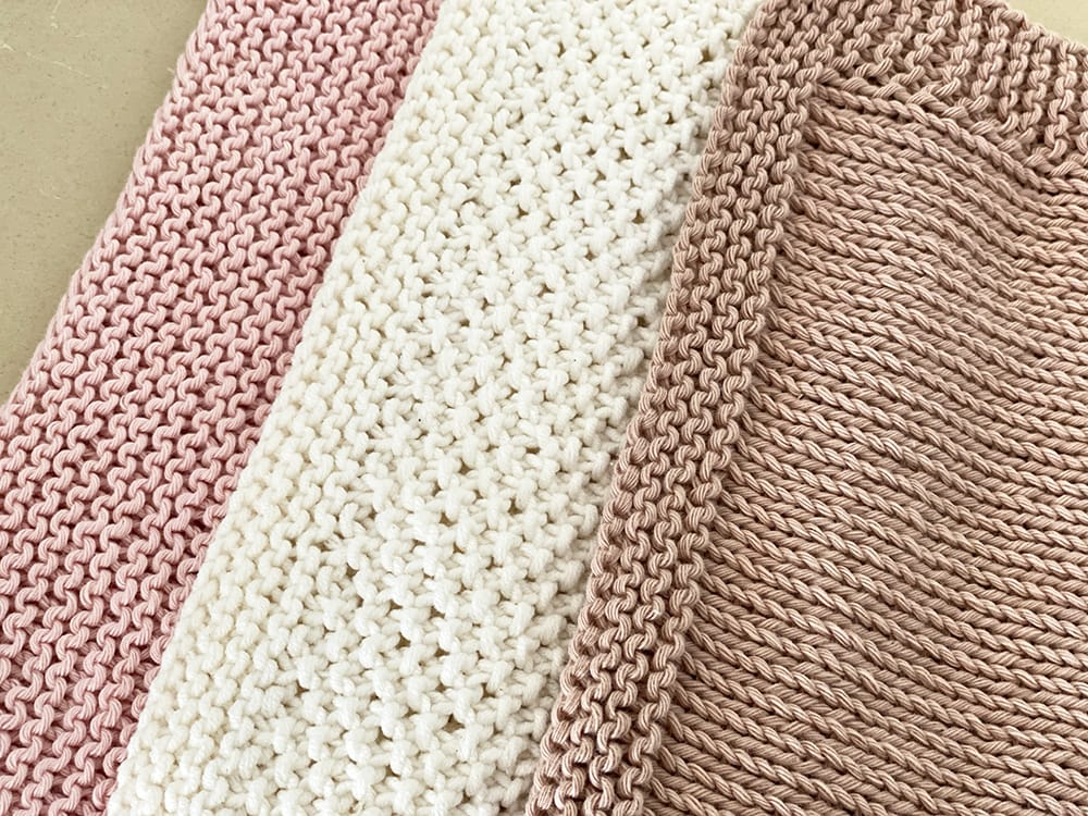 knitted dishcloths in three different stitch patterns