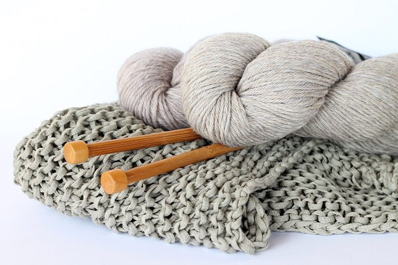knitting needles and a skein of yarn