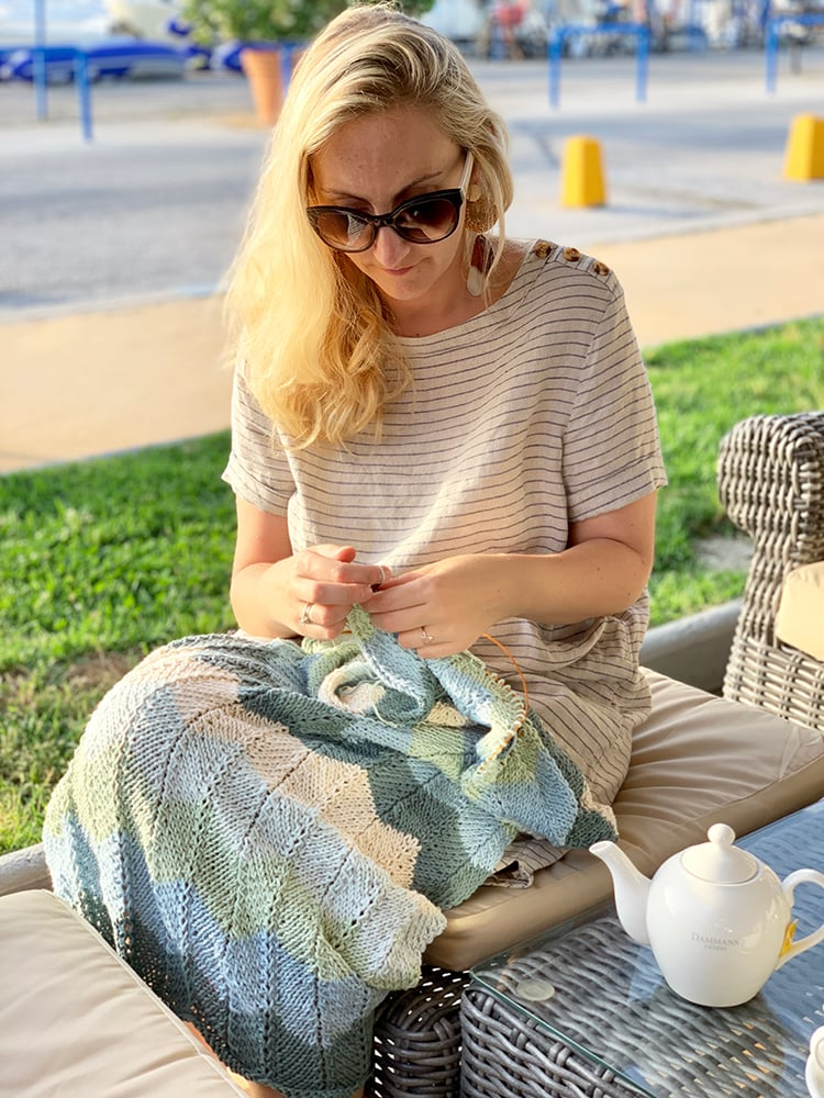 woman sitting knitting in public