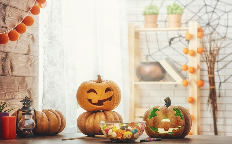 carved pumpkins and candy bowls ready for halloween