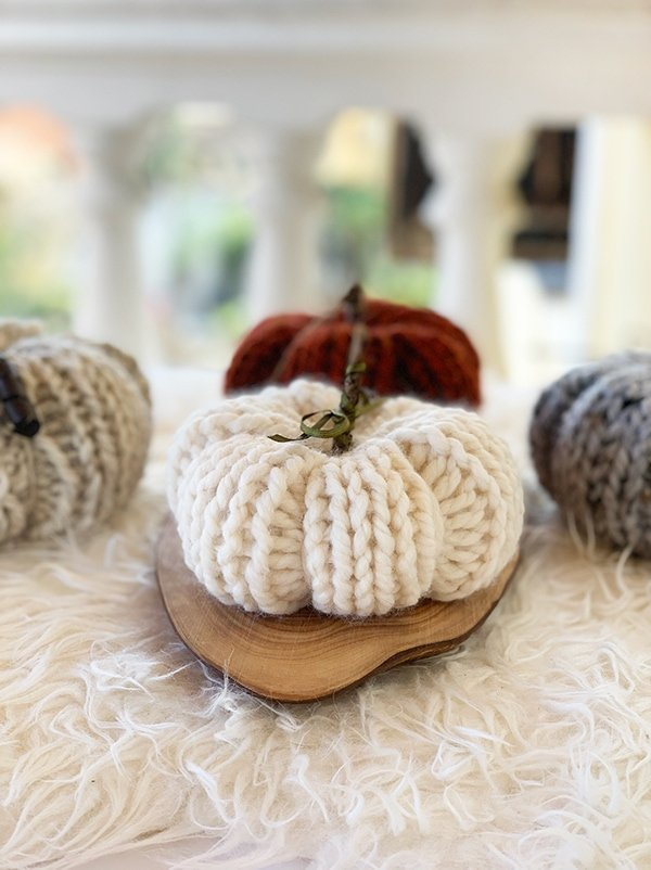 white knitted pumpkin in Lion Brand fisherman wool ease thick and quick yarn