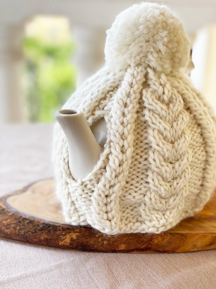 Cable knit teapot cozy spout view