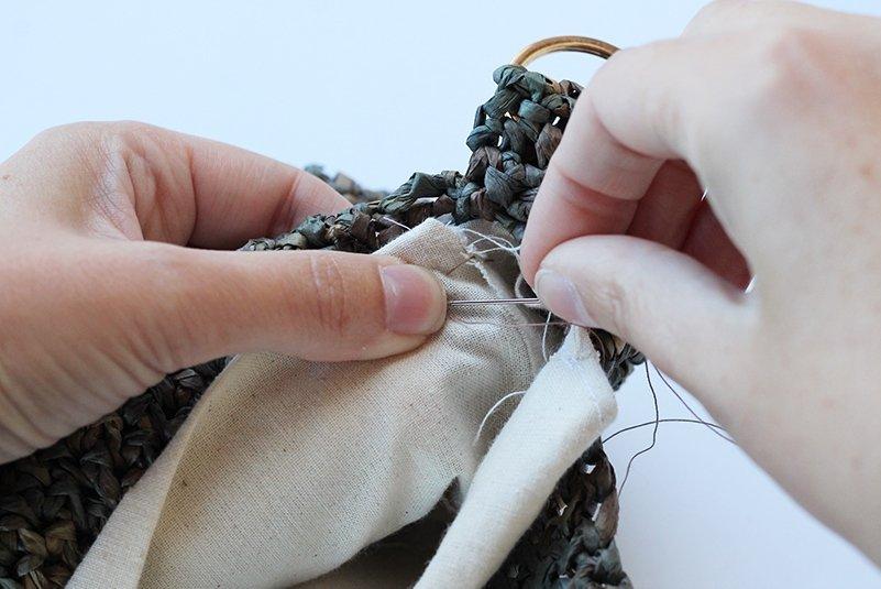 hand stitching the bag lining