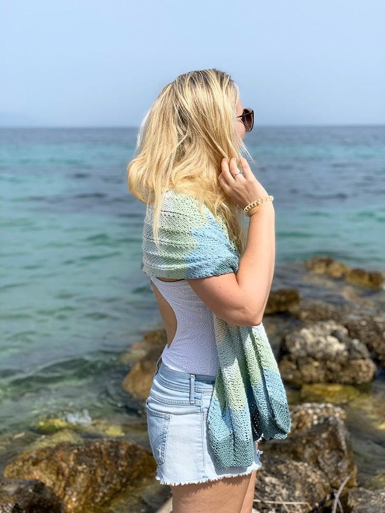 woman at the beach weaing a cotton shawl