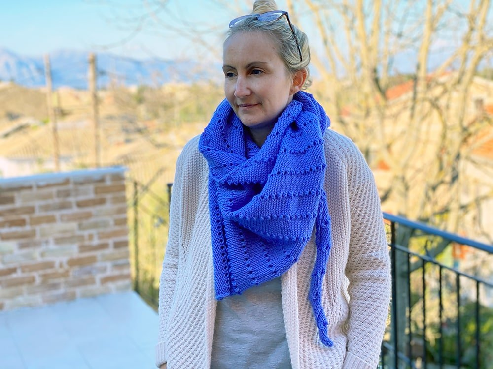wearing the knitted shawl