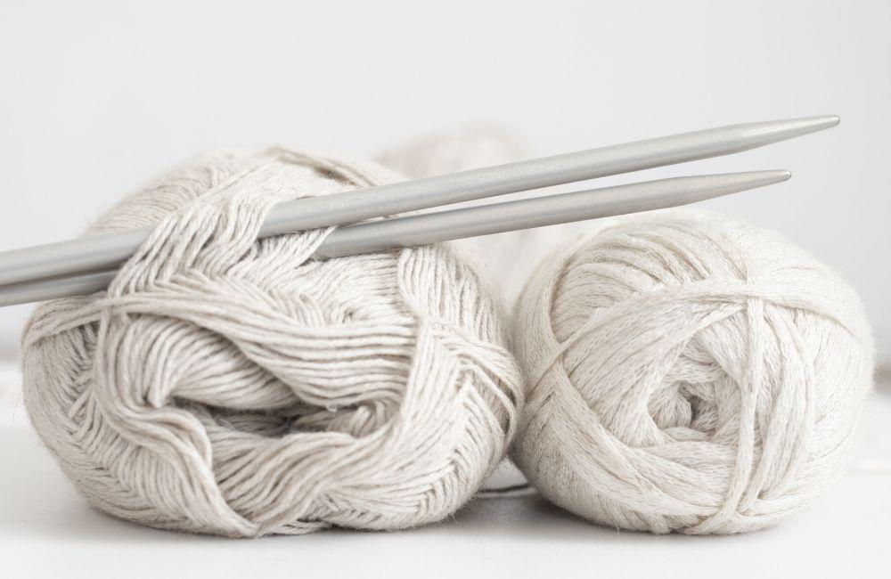 white yarn and needles